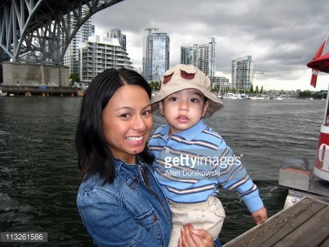 Stock Photo : mother and son downtown waterfront cityscape