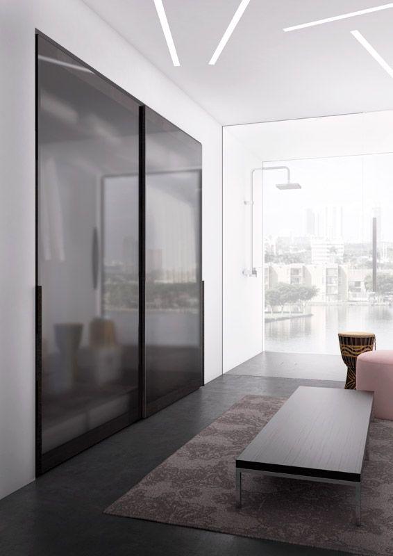 VITRUM scorrevole a due ante in vetro satinato fumè telaio brunito | With two sliding doors in satin fumè glass burnished frame | PIANCA | www.pianca.com