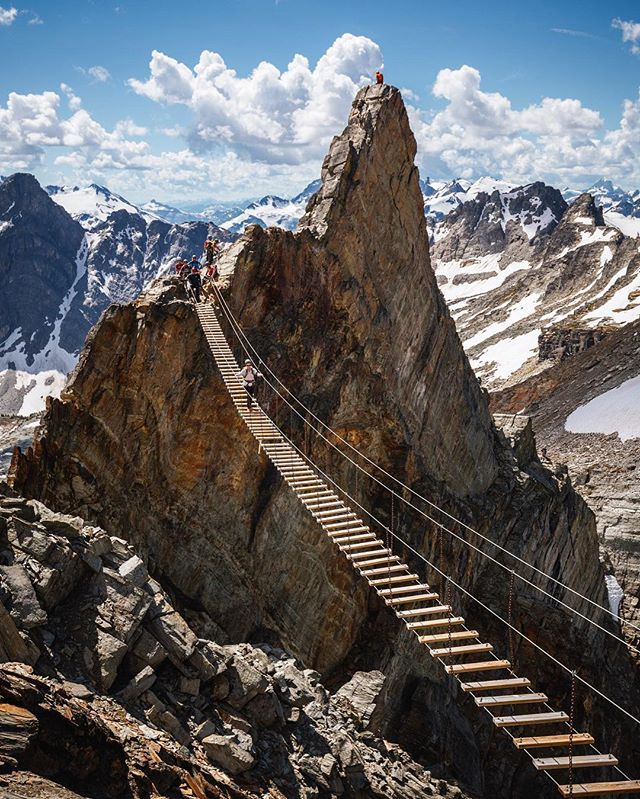 Bobby Burns Lodge, Banff Alberta Canada | We made our way up and over the jagged spire then crossed the bridge, 600 meters above the valley floor en route to the summit of Mt. Nimbus. Just an average day when you're on a trip with @cmh_heli... #cmhheli