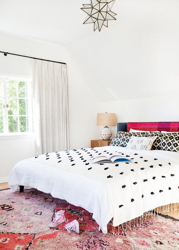 White bedroom with pops of blue and pink