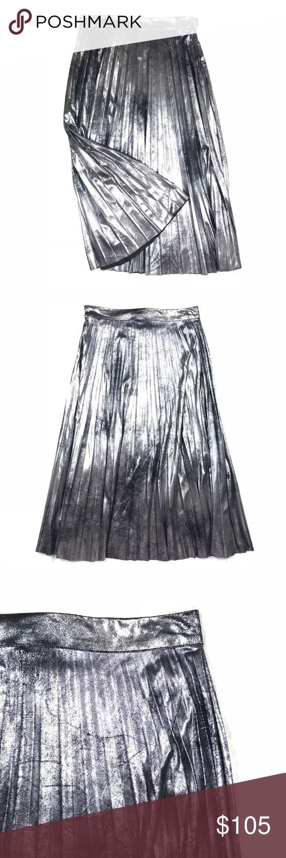 "Romeo & Juliet Metallic Pleated Midi Skirt Brand New! * Hidden side zip closure, metallic coated-effect * Pleated body, midi length * 100% Polyester * Hand wash cold, line dry  Measurements: - Waist: 28""  - Length: 30"" Romeo & Juliet Couture Skirts Midi"