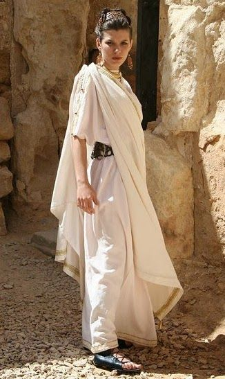 A himation was a wrap worn by Greek men and women. It was draped in different ways—e.g., as a shawl, a cloak, or a head covering.  It was usually worn over a chiton and/or peplos, but was made of heavier drape and played the role of a cloak.