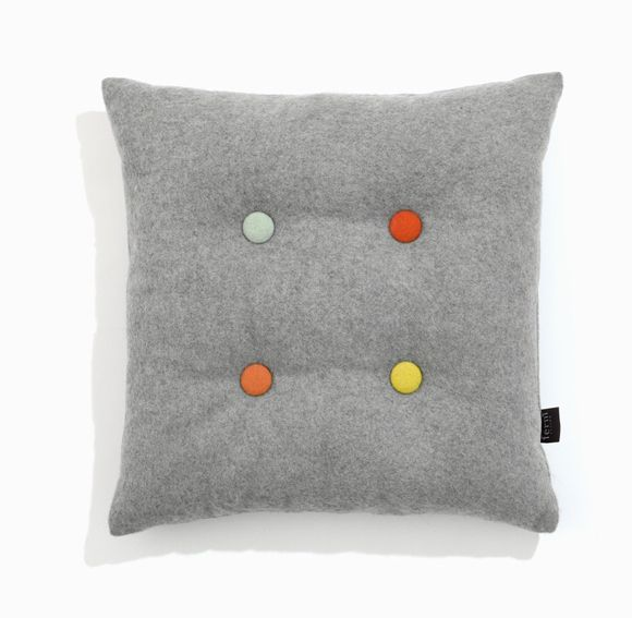 colored buttons on a solid pillow