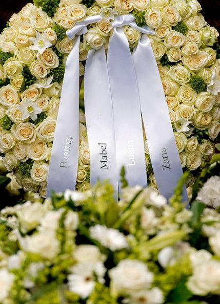 Floral tributes are left next to the grave of Prince Friso of the Netherlands after his funeral ceremony at the Stulpkerk Church on 16 Aug 2013 in Lage Vuursche, Netherlands. The prince is buried in the cemetery bordering Drakensteyn Castle.