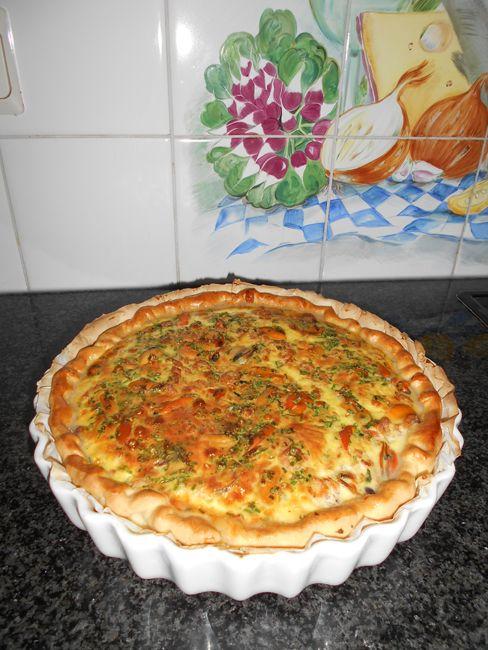 Recept voor Quiche met mosselen, garnalen en prei. Meer originele recepten en…
