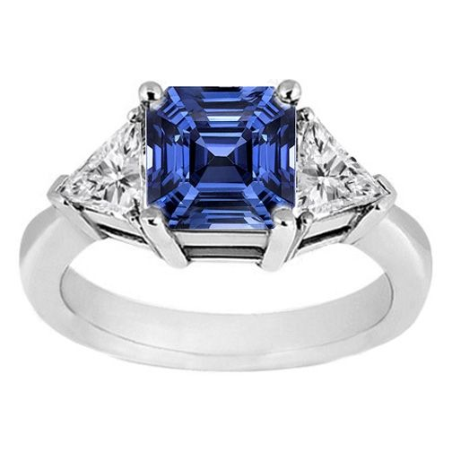 Royal Blue Sapphire Asscher Cut, flanked by trillion diamonds engagement ring