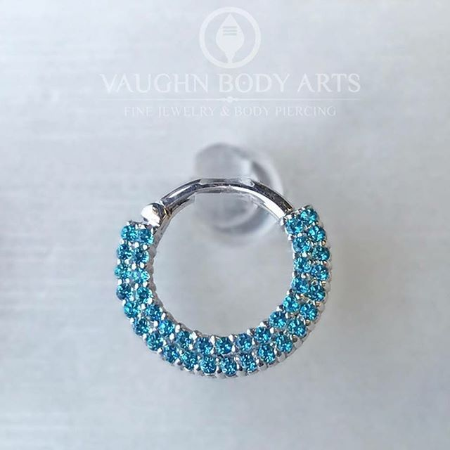 This Double Dahlia clicker from BVLA is absolutely stunning.  Made from 14k white gold, this gorgeous little clicker is packed with forty three (43!) Paraiba Topaz.  If you're looking to make your piercing really stand out, this is a spectacular piece.  In stock now at Vaughn Body Arts.  #app #appmember #safepiercing #bvla #gold #clicker #jewelry #bodyjewelry #septum #daith #helix #piercing #bodypiercing #fashion #style #ootd #monterey #montereybay #carmel #seaside #salinas #marina…