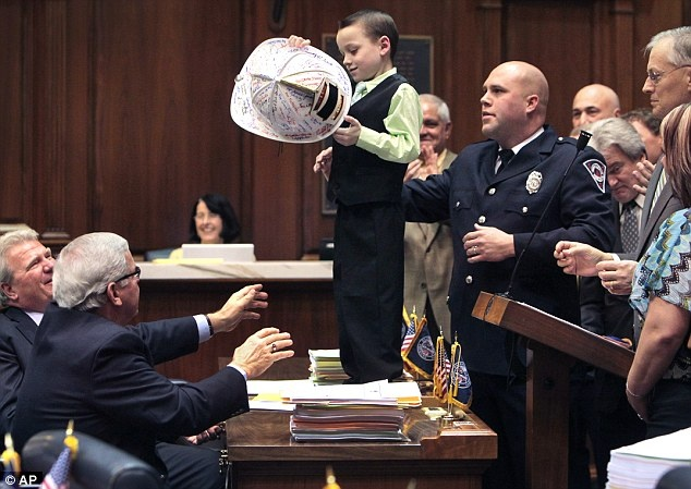 Little Brandon Vinson has always dreamt of becoming a firefighter like his father.   However, being diagnosed with cystic fibrosis threatened to dash those hopes.   But his wish came true this week after he was made an honorary firefighter by the Indiana State House of Representatives.      Read more: http://www.dailymail.co.uk/news/article-2093000/Little-Brandon-Vinson-7-cystic-fibrosis-wants-like-fireman-father-honorary-firefighter.html#ixzz1l05io3ug