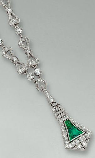 EMERALD AND DIAMOND NECKLACE, TIFFANY & CO., CIRCA 1910  The necklace designed as a series of tied bows millegrain-set with circular- and single-cut stones, suspending a shield-shaped  diamond-set motif centring on calibré-cut emeralds, signed Tiffany & Co. length approximately 345mm,