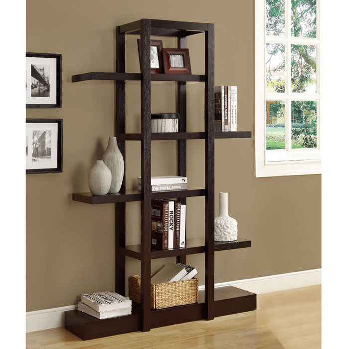 This open bookcase and wall unit features large storage and display areas.