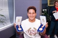 FILE- In this Sept. 28, 1988, file photo, two-time double gold medalist Greg Louganis shows off the two medals he won at the 1988 Summer Olympic Games in Seoul as he arrives in Los Angeles, Calif. As an athlete mentor at the London Olympics, Louganis is trying to make sure the stress of winning medals isn't heaped on the shoulders of American divers, who have been chasing his standard of excellence since he became the sport's icon in the 1980s. The U.S. has been blanked in diving in two…
