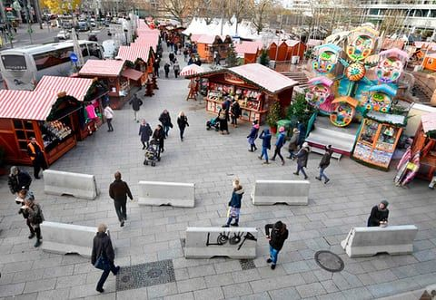 Berlin, Germany: People walk past concrete security barriers at a Christmas market in Breitscheidplatz square
