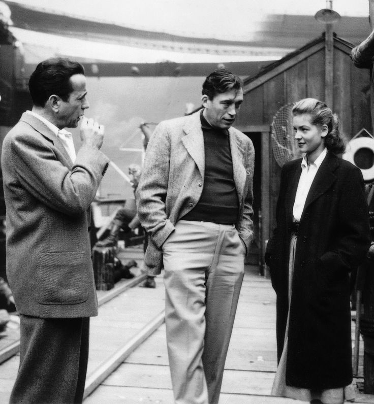 "Lauren Bacall, Humphrey Bogart and John Huston on the set of ""Key Largo"" - Dir. J. Huston, 1948."