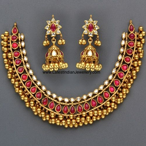 Stunning Kundan Necklace set in 22 karat Gold with Gold Balls hanging. Paired with Beautiful Jhumkas | Latest Indian Jewellery Designs