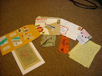 In this letter, you have to open four successively smaller envelopes before you get to the letter. I didn't want each envelope to contain only another envelope, so there is a small  trinket/gift included in each one. Another way to do this would be to include one page of the letter in each envelope so you have to keep opening to keep reading. Just for fun, the smaller envelopes include mailing labels and cancelled stamps.
