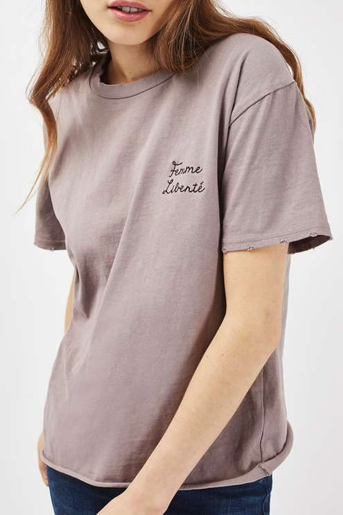 Slogan tees are a casual-cool staple this season - we love this mauve tee with mini 'Femme Liberte' motif to the chest. Team this easy-to-wear piece with ankle-grazing jeans for every inch French-girl chic. #Topshop