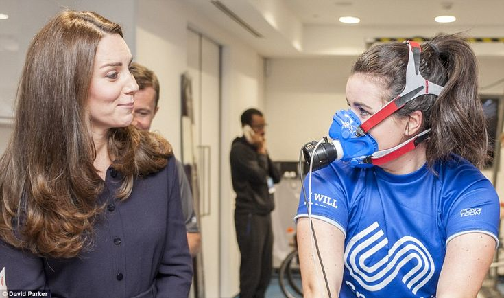 Are you OK? The Duchess looks nonplussed as she spies Emma Allen from Southampton in a cumbersome looking face mask