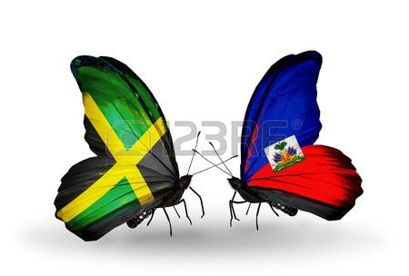 Two butterflies with flags on wings as symbol of relations Jamaica and Haiti Stock Photo