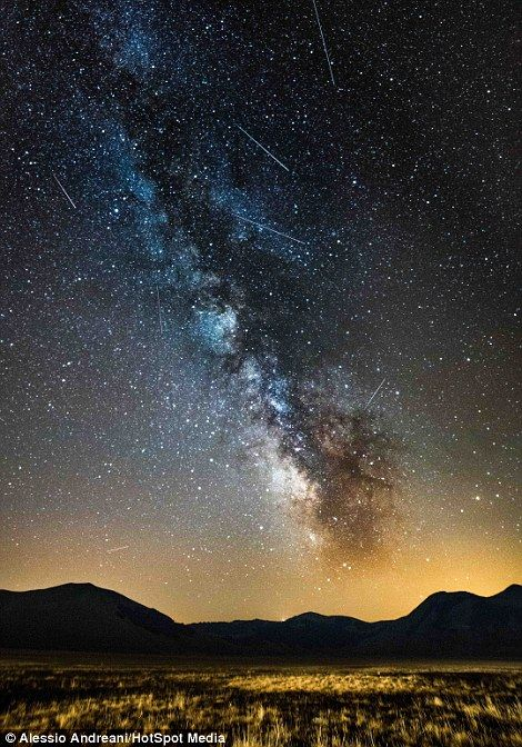 This image, Perseid Meteor Shower 2012, is a merge of five photos taken in Italys Castelluccio di Norcia during a meteor shower in the night sky