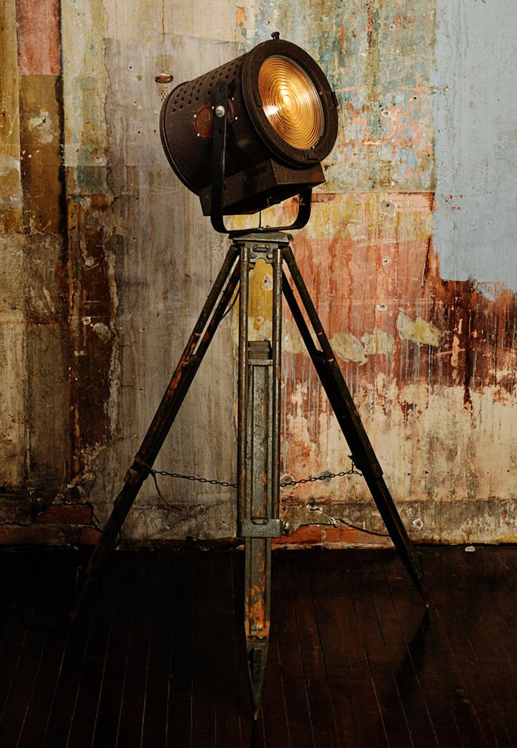 floor lamp from vintage theater light and tripod.