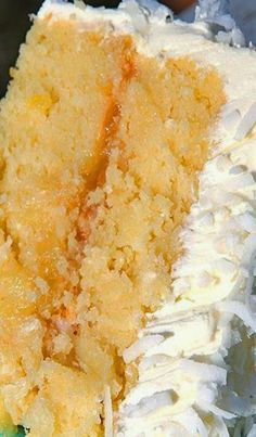 "Nanny's Famous Coconut-Pineapple Cake - This coconut pineapple cake recipe is sure to please family and friends, with its surprising blend of flavors and a ""secret"" ingredient: lemon-lime soft drink."