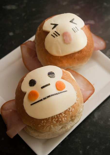 Monkey Sandwich: deli ham ears; white cheese face on bun w/ yellow/orange cheese cheeks (or 2 very thin carrot slices); I would cut cheese for other features and add black olive halves for eyes, and slivers for nose and mouth....kj