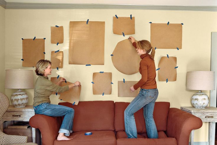 Cut out the shapes, and arrange them on the wall using strips of painter's tape. Group small, similar pieces together to make a greater impact.
