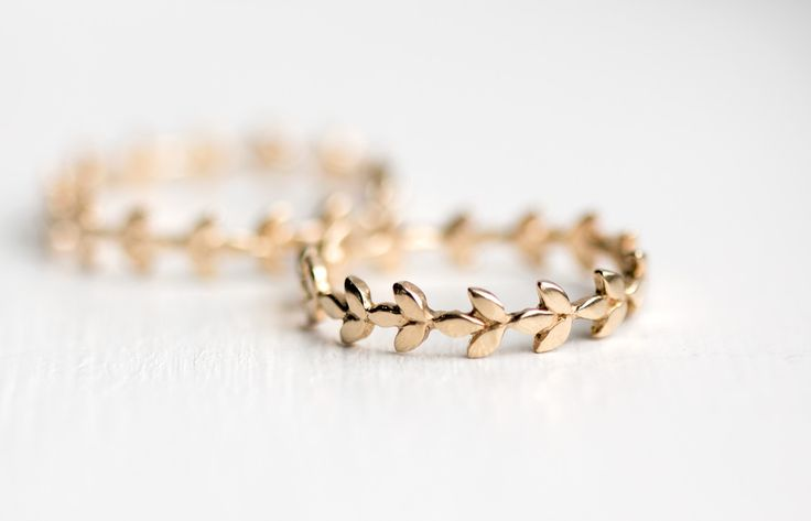 A solid 14k gold stackable ring with an eternity vine leaf signature design by Melanie Casey!  Shop our collection of handmade delicate rings at Melanie Casey Jewelry