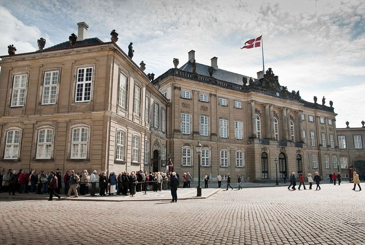 Amalienborg Palace in Copenhagen, one of Denmark's many royal residences, is made up of fo...