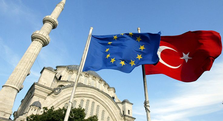Flags of Turkey, right, and the European Union are seen in front of a mosque in Istanbul, Turkey
