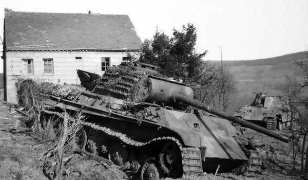 Two abandoned German Panther tanks of Kampfgruppe Peiper, somewhere in the Ardennes, Belgium. #WW2