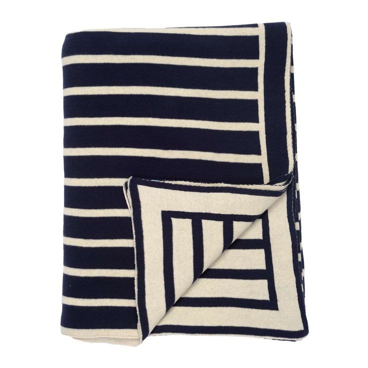 A beautiful nautical inspired throw blanket with navy and white stripes.