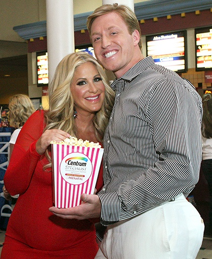 "Parents to be Kim Zolciak of Bravo TV's The Real Housewives of Atlanta and her husband Kroy Biermann caught a premiere event of ""What to Expect When Expecting"" that the makers of Centrum Specialist Prenatal multivitamins hosted in Atlanta, Georgia on Wednesday May 16."