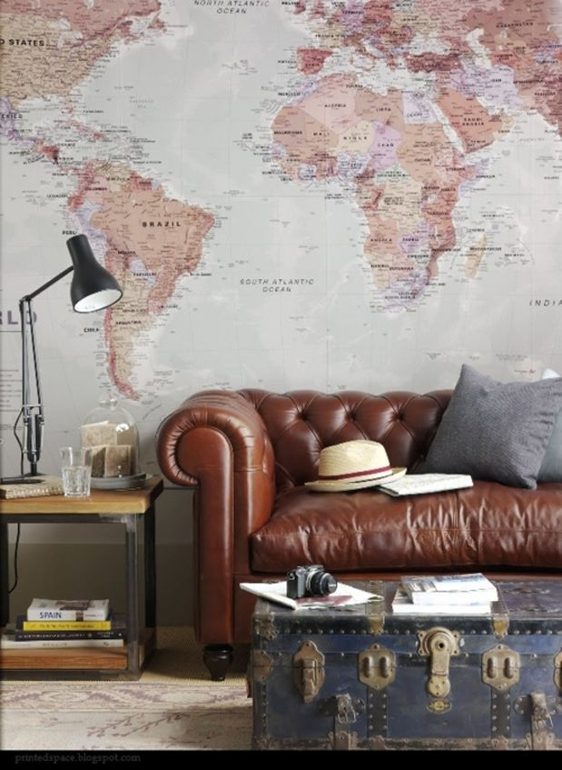 Masculine room--map, leather chesterfield, old trunk, industrial side table.