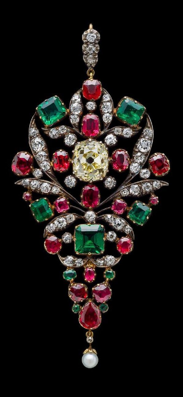 An antique gold, silver, yellow diamond, diamond and gem-set brooch, circa 1880. Set to the centre with a yellow diamond and further set with diamonds, emeralds, rubies and a pearl. #antique