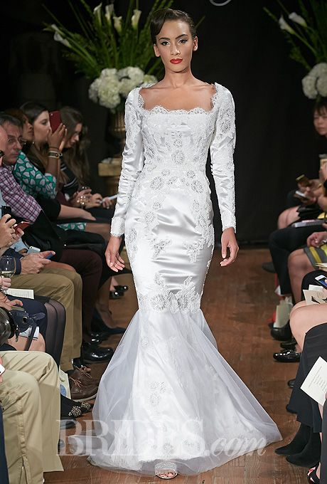 """Brides.com: Sarah Jassir - Fall 2014. """"Charlotte"""" long sleeved crepe-back satin mermaid wedding dress with lace appliques and tulle skirt, Sarah Jassir"""