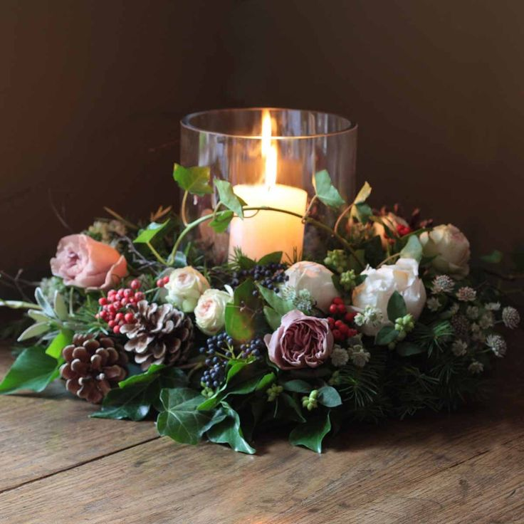 To complete the look select the large hurricane lamp and candle from your own colors scheme. Use seasonal wreaths with live greenery tucked in to give green a fresh look.