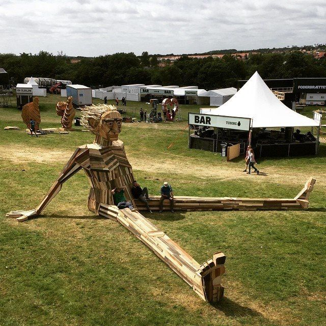 "NorthSide 2015, Aarhus, Denmark - ""Ben Chiller"" large wooden sculpture made entirely of reused scrapwood. Made by artist Thomas Dambo"