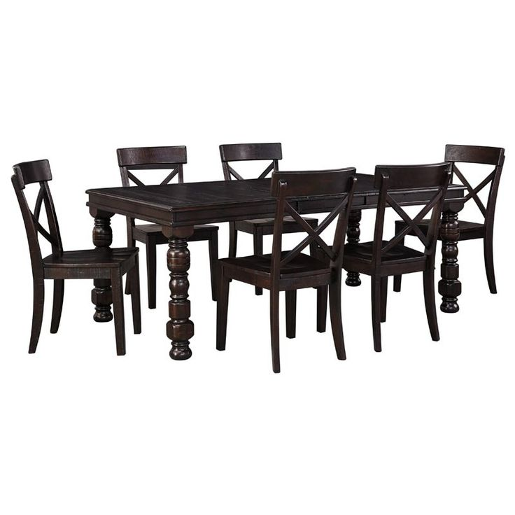 The Rustique 7 Piece Dining Set by Ashley Furniture is made out of solid pine displayed in a dark brown espresso/merlot finish. Includes 6 chairs and 1 table. This rich, classically styled dining set is ideal for holidays and every day!  Rustique 7 Piece Dining Set | Weekends Only Furniture and Mattress