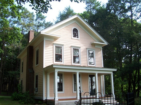 Historical renovation project by A.Tyler Renovation LLC, Marlborough, Conn. Features Cedar Impressions polymer siding in the color Coral.