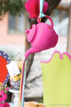 """Hanging Teapots with """"Ribbon Tea"""" from an Alice in Wonderland Birthday Party via Kara's Party Ideas KarasPartyIdeas.com (7)"""