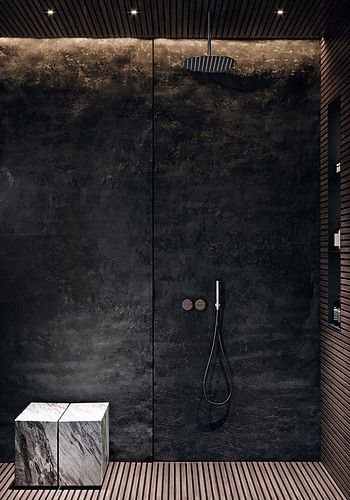Edgy Bathroom // Black stone shower wall with integrated lighting, slatted wood floor, marble seat