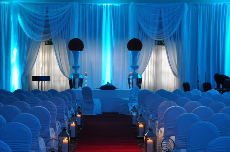Gorgeous civil partnership wedding setting with blue lighting