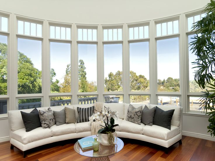 This Beautiful Room Features A Rounded Window With Vast Views Of The Entire City Perfect For Relaxing Or Entertaining