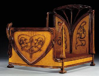 CARVED MAHOGANY AND BURLWOOD BEDSTEAD  LOUIS MAJORELLE, CIRCA 1900