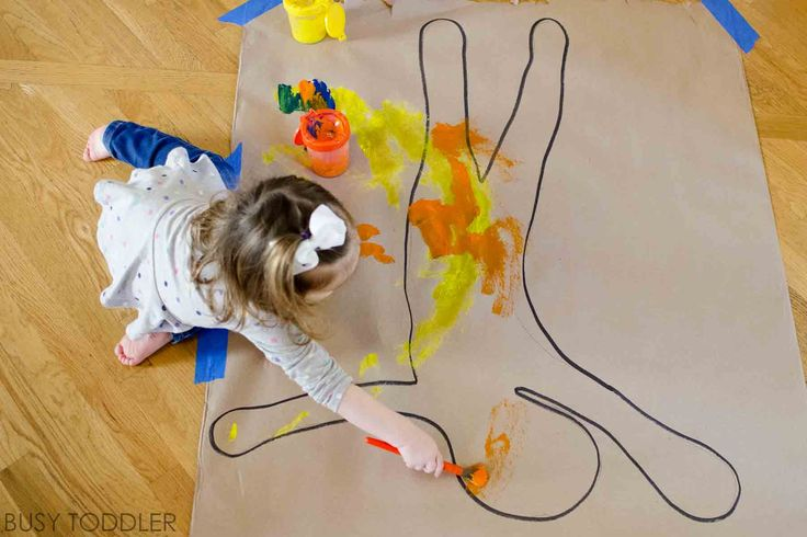 What a fun painting activity! Check out body paint process art for toddlers & preschooler. Kids will love this easy painting activity that sets up fast!