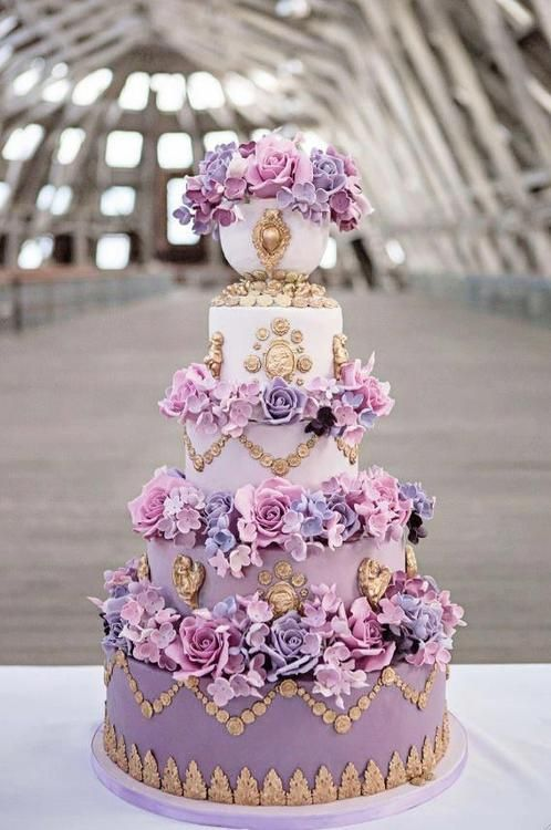 ROCOCO & LATE BAROQUE  Marie Antoinette – a decadent purple ombre cake with edible gold cherubs, cameos and handcrafted sugar flowers, this cake is perfect for the princess bride who wants a statement cake. By Elizabeth's Cake Emporium