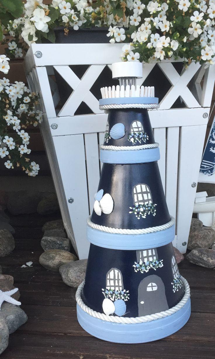 Saviruukuista majakka aurinkokennovalolla terassille/clay pots lighthouse