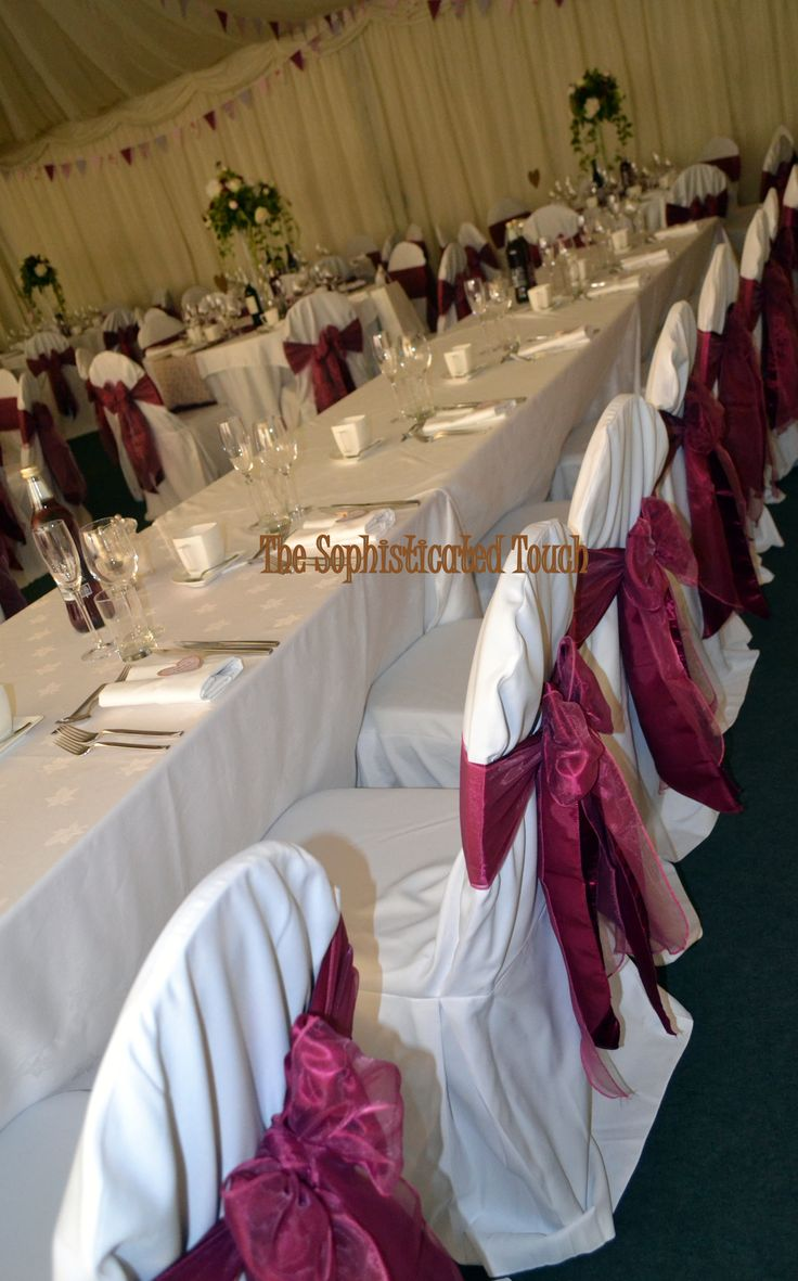 Double Bows of Burgundy Satin and Raspberry Organza on White Chair Covers  The Sophisticated Touch ...Chair Covers by Design