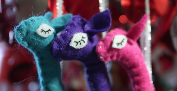 We have designed and created a set of festive felt giraffe's perfect for that funky Christmas tree.